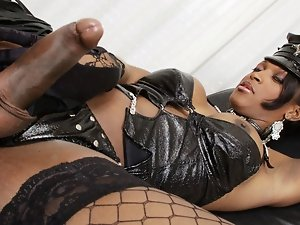 Fabiola... A black domina panther, in full fetish outfit humiliating her slave and having great sex.