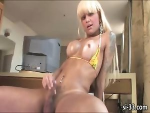 Busty blonde shemale Izabela shoots cum