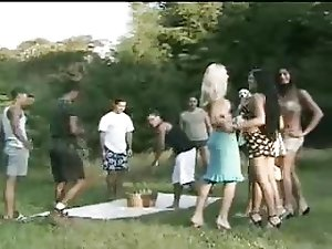 Brunette tranny in outdoor gangbang