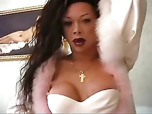 Shemale with large cock in stockings heels